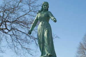 Statue of white woman holding hatchet and scalps sparks backlash in New England